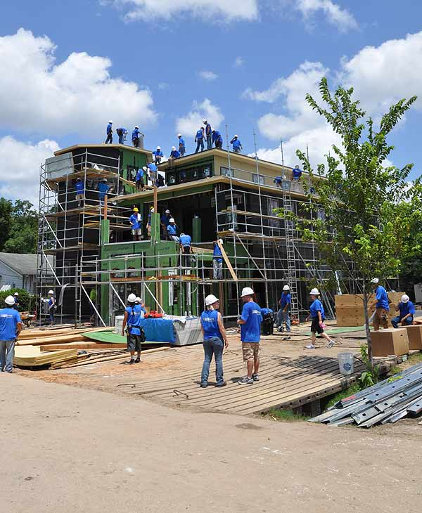 "<div class=""meta image-caption""><div class=""origin-logo origin-image ""><span></span></div><span class=""caption-text"">These photos are from the fifth day of the build of a house for a southeast Houston family as part of the hit ABC show, 'Extreme Makeover; Home Edition.'  The family is currently in Paris and will be back this weekend to see their new home.  Volunteers are still needed.  If you'd like to help, click here. (ABC13)</span></div>"