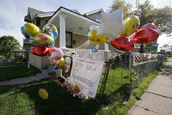 Balloons fly outside the home of Gina DeJesus Tuesday, May 7, 2013, in Cleveland. DeJesus, Amanda Berry and Michelle Knight, who went missing separately about a decade ago, were found in a home just south of downtown Cleveland and likely had been tied up during years of captivity, said police, who arrested three brothers. <span class=meta>(AP Photo&#47;Tony Dejak)</span>