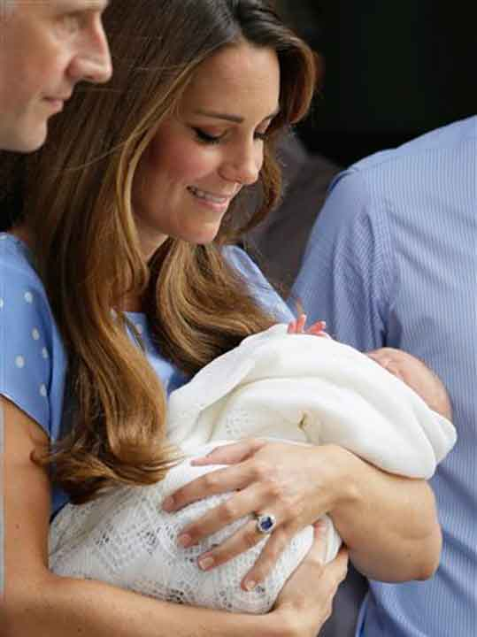 Kate, Duchess of Cambridge holds the Prince of Cambridge, Tuesday July 23, 2013, as they pose for photographers outside St. Mary&#39;s Hospital exclusive Lindo Wing in London where the Duchess gave birth on Monday July 22. The Royal couple are expected to head to London???s Kensington Palace from the hospital with their newly born son, the third in line to the British throne.   <span class=meta>(AP Photo&#47;Alastair Gran)</span>