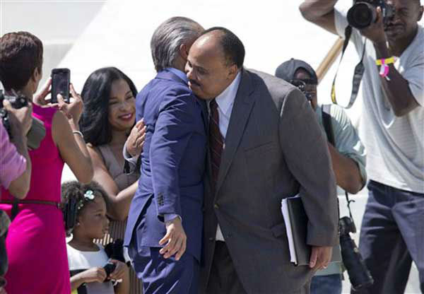 Martin Luther King III, right, hugs Rev. Al Sharpton after speaking during an event to commemorate the 50th anniversary of the 1963 March on Washington at the Lincoln Memorial, Saturday, Aug. 24, 2013, in Washington. In the background at left are Martin Luther King III&#39;s wife Arndrea King and daughter Yolanda &#40;AP Photo&#47;Carolyn Kaster&#41; <span class=meta>(Photo&#47;Carolyn Kaster)</span>