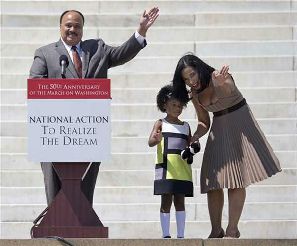 "<div class=""meta ""><span class=""caption-text "">Martin Luther King III, his wife Arndrea King and daughter Yolanda wave from the steps of the Lincoln Memorial in Washington Saturday, Aug. 24, 2013, to the crowd gathered for the 50th anniversary commemoration of the Aug. 28, 1963, March on Washington.  (AP Photo/Carolyn Kaster) (Photo/Carolyn Kaster)</span></div>"