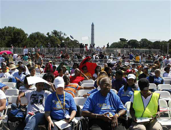"<div class=""meta image-caption""><div class=""origin-logo origin-image ""><span></span></div><span class=""caption-text"">People listen to speakers at a rally to commemorate the 50th anniversary of the 1963 March on Washington on Saturday, Aug. 24, 2013, in Washington. Tens of thousands of people marched to the Martin Luther King Jr. Memorial and down the National Mall on Saturday, to commemorate King's famous """"I Have a Dream"" speech, delivered Aug. 28, 1963, during the March on Washington, and pledging that his dream includes equality for gays, Latinos, the poor and the disabled. (AP Photo/Jon Elswick) (Photo/Jon Elswick)</span></div>"