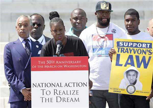 Sabrina Fulton, mother of slain teenager Trayvon Martin speaks as she is surrounded by Rev. Al Sharpton, left, Tracy Martin, father of Trayvon Martin, second from right, and Jahvaris Fulton, brother of Trayvon Martin, right, during an event to commemorate the 50th anniversary of the 1963 March on Washington at the Lincoln Memorial, Saturday, Aug. 24, 2013, in Washington. &#40;AP Photo&#47;Carolyn Kaster&#41; <span class=meta>(Photo&#47;Carolyn Kaster)</span>