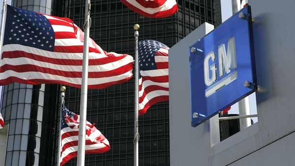 ** FILE ** U.S. flags are shown outside of General Motors world headquarters in a Detroit file photo from April 18, 2006. (AP Photo/Paul Sancya, File)