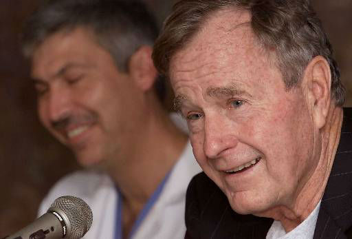 Former President George Bush, right, answers questions about his heart condition as cardiologist Mark Hausknecht laughs during a news conference at Methodist Hospital on Friday, Feb. 25, 2000 in Houston. Bush spent Thursday night in a Florida hospital and was released Friday after being treated for an irregular heartbeat. Doctors will investigate whether Bush&#39;s thyroid disorder, called Graves&#39; disease, caused the irregularity. It was responsible for a similar episode he suffered while jogging in May 1991.  <span class=meta>(AP Photo&#47; DAVID J. PHILLIP)</span>