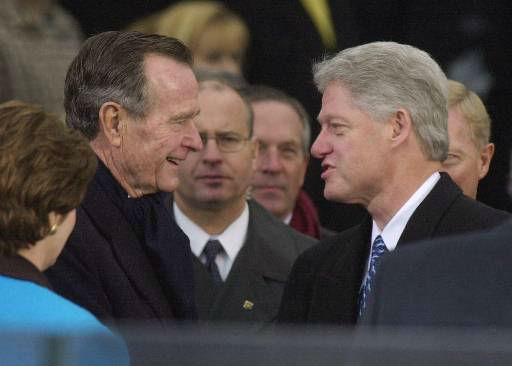 President Clinton is greeted by former President George Bush as he arrives at the U.S. Capitol for inauguration ceremonies Saturday, Jan. 20, 2001, in Washington. &#40;AP Photo&#47;Ron Edmonds&#41; <span class=meta>(AP Photo&#47; RON EDMONDS)</span>
