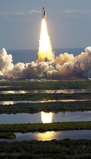 "<div class=""meta image-caption""><div class=""origin-logo origin-image ""><span></span></div><span class=""caption-text"">The space shuttle Columbia's solid rocket boosters are reflected in ponds during liftoff Thursday morning Jan. 16, 2003 at the Kennedy Space Center in Cape Canaveral, Fla.  Seven astronauts, including Ilan Ramon, the first Israeli astronaut, are beginning a 16-day mission. (AP Photo/Chris O'Meara) (AP Photo/ CHRIS O'MEARA)</span></div>"