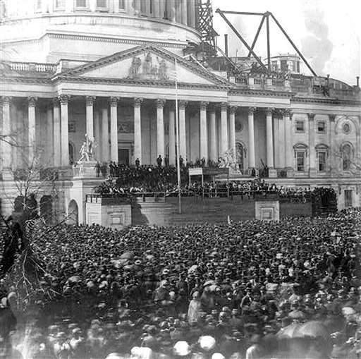 "<div class=""meta ""><span class=""caption-text "">** FILE ** This photograph from the album of Benjamin Brown French, shows the crowd surrounding the East front of the U.S. Capitol, still under construction, during the first inauguration of President Abraham Lincoln March 4, 1861. In 1865, for Lincoln's second inauguration, blacks march for the first time in the inaugural procession. (AP Photo/Library of Congress, File) (AP Photo/ Anonymous)</span></div>"