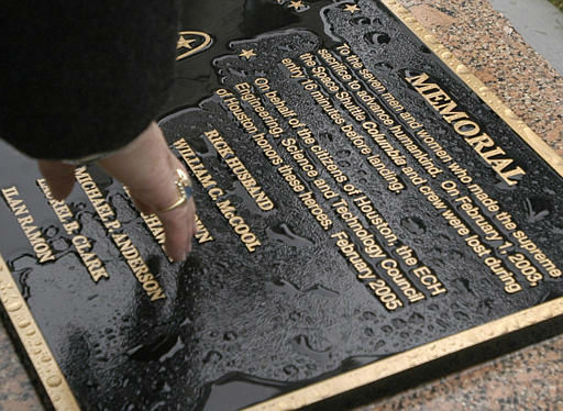 Rain puddles on the face of the memorial plaque dedicated to the astronauts of the Space Shuttle Columbia, Tuesday, Feb. 1, 2005,  in Houston, two years after the spacecraft broke apart on re-entry. All seven astronauts died in the accident. &#40;AP Photo&#47;Pat Sullivan&#41; <span class=meta>(AP Photo&#47; PAT SULLIVAN)</span>
