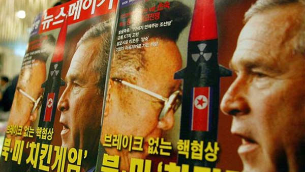 A South Korean man walks past magazines featuring U.S. President George W. Bush and North Korean leader Kim Jong Il at a bookstore in Seoul Wednesday, April 27, 2005. South Korean Foreign Minister Ban Ki-moon Wednesday urged communist North Korea to return to the negotiating table after top U.S. envoy on the North Korean nuclear issue said the future of nuclear talks was uncertain. The Korean letters on the magazines read: &#34;Nuclear Meeting Without Break.&#34; &#40;AP Photo&#47;Lee Jin-man&#41; <span class=meta>(AP Photo&#47; LEE JIN-MAN)</span>