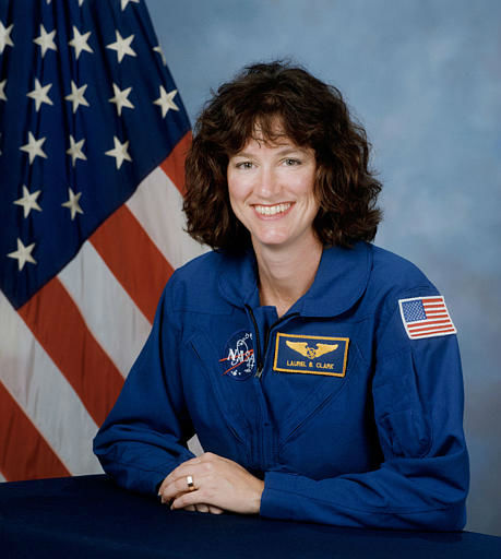 Laurel Clark, 41, a Navy diving medical officer aboard submarines, who was one of the seven astronauts on the space shuttle Columbia, is seen in this undated handout photo from NASA.  Space shuttle Columbia broke apart in flames over Texas on Saturday, Feb. 1, 2003, killing all seven astronauts just 16 minutes before they were supposed to glide to ground in Florida. &#40;AP Photo&#47;NASA&#41; <span class=meta>(AP Photo&#47; Anonymous)</span>