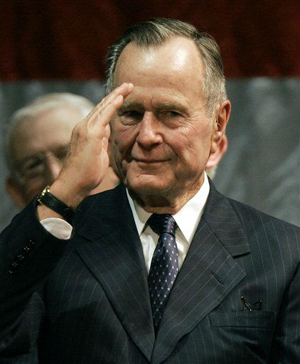 Former President George H.W. Bush salutes the audience at the Temple Theater Tuesday, May 16, 2006, in Meridian, Miss., after being acknowledged during the funeral of former Rep. G.V. &#34;Sonny&#34; Montgomery. Montgomery, a conservative Democrat, had represented an east-central Mississippi district in Congress from 1967 to 1997, and for 13 years chaired the House Veterans Affairs Committee. He died last Friday at a Meridian, Miss., hospital at the age of 85.  <span class=meta>(AP Photo&#47; ROGELIO SOLIS)</span>