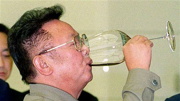 **FILE** North Korean leader Kim Jong-Il downs a drink during a toast with a South Korean media representitive Kum Chang-Tae in Pyongyang, North Korea Saturday August 12, 2000. North Korean leader Kim Jong Il loves his fancy food. The Bush administration wants North Korea&#39;s attention. So, like a scolding parent, it is working to make it tougher for that country&#39;s eccentric leader to buy iPods, plasma televisions and Segway electric scooters.  &#40;AP Photo&#47;Yonhap&#41; ***KOREA OUT*** <span class=meta>(AP Photo&#47; Anonymous)</span>