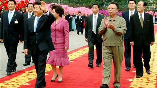 In this photo taken by North Korea&#39;s official Korean Central News Agency and released by Korea News Service in Tokyo Tuesday, Oct. 2, 2007, South Korean President Roh Moo-hyun, front left, waves as North Korean leader Kim Jong Il, front right, claps during welcoming ceremony for Roh in Pyongyang, North Korea, Tuesday, Oct. 2, 2007. Roh&#39;s wife Kwon Yang-sook is seen behind him and North&#39;s No. 2 leader Kim Yong Nam is on back right. &#40;AP Photo&#47;Korean Central News Agency via Korea News Service&#41;  ** SOUTH KOREA OUT ** <span class=meta>(AP Photo&#47; Anonymous)</span>