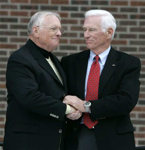 Former astronaut Neil Armstrong, left, is congratualted by fellow ex-astronaut Gene Cernan following the dedication ceremony of the Neil Armstrong Hall of Engineering at Purdue University in West Lafayette, Ind., Saturday, Oct. 27, 2007. Armstrong, a Purdue alum, became the first man to walk on the Moon in 1969. Cernan, also a Purdue alum, was the last person to walk on the Moon.  <span class=meta>(AP Photo&#47; Michael Conroy)</span>