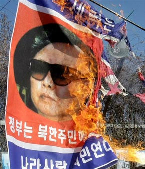 A picture of North Korean leader Kim Jong Il on a flag is burned by anti-North Korean protesters during a rally at the Imjingak Pavilion near the border village of the Panmunjom &#40;DMZ&#41; that separates the two Koreas since the Korean War, north of Seoul, South Korea, Wednesday, Dec. 3, 2008. Defectors and anti-North Korean activists ballooned about 100,000 leaflets condemning leader Kim Jong Il into the communist country for a second straight day Wednesday. &#40;AP Photo&#47; Lee Jin-man&#41; <span class=meta>(AP Photo&#47; Lee Jin-man)</span>