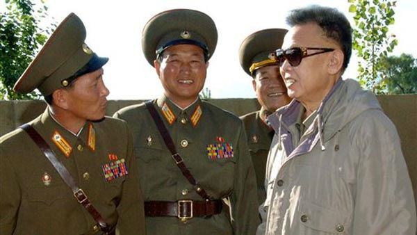 "<div class=""meta ""><span class=""caption-text "">In this undated photo released by Korean Central News Agency via Korea News Service in Tokyo, Japan, Sunday, June 14, 2009, North Korean leader Kim Jong Il, right, inspects the command of the 7th Infantry Division of the Korean People's Army at an undisclosed location in North Korea. A news report says Wednesday, June 24, 2009, the youngest son of the North Korean leader has taken charge at the country's spy agency as part of a succession process, and oversaw the handling of two American journalists held in the communist nation. (AP Photo/Korean Central News Agency via Korea News Service)  ** SOUTH KOREA OUT ** (AP Photo/ Anonymous)</span></div>"