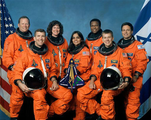 This undated file photo released by NASA shows STS-107 crew members in their group photo. Space Shuttle Columbia crew, left to right, front row, Rick Husband, Kalpana Chawla, William McCool, back row, David Brown, Laurel Clark, Michael Anderson and Israeli astronaut Ilan Ramon are shown in this undated crew photo. The Israeli military says an F-16 warplane has crashed during a routine flight over the West Bank, killing the pilot. Military officials identified the dead pilot as Assaf Ramon, son of the late Ilan Ramon, Israel&#39;s first astronaut. Ilan Ramon was one of the seven crew members killed in 2003 when Columbia exploded just minutes before it was scheduled to land.  &#40;AP Photo&#47;NASA, File&#41; <span class=meta>(AP Photo&#47; Anonymous)</span>