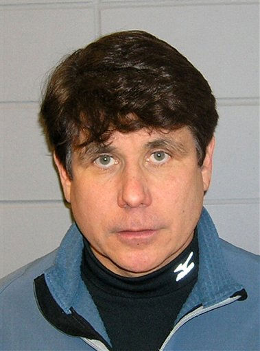 "<div class=""meta image-caption""><div class=""origin-logo origin-image ""><span></span></div><span class=""caption-text"">FILE - This Dec. 9, 2008 Department of Justice file booking photo shows Rod Blagojevich following his arrest in Chicago. The former Illinois governor is scheduled to the Federal Correctional Institution Englewood in Littleton, Colo., March 15, 2012,  to begin serving a 14-year sentence for corruption. He will be identified as No. 40892-424 in prison and his life will be strictly regimented. The Democrat will have to work an eight-hour-a-day menial job and he'll be subject to half a dozen head counts a day.  (AP Photo/Department of Justice, File) (AP Photo/ Anonymous)</span></div>"