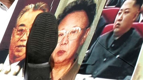 "<div class=""meta image-caption""><div class=""origin-logo origin-image ""><span></span></div><span class=""caption-text"">A shoe hurled by a North Korean defector hits a placard showing photos of North Korean leader Kim Jong Il, center, his late father Kim Il Sung, left, and his youngest son Kim Jong Un, during a rally against the North's succession in Seoul, South Korea, Friday, Oct. 8, 2010. (AP Photo/Ahn Young-joon) (AP Photo/ Ahn Young-joon)</span></div>"