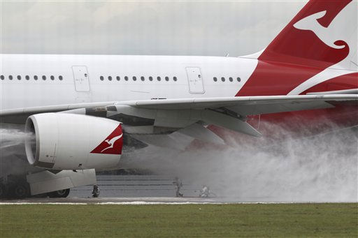 Firefighters surround a Qantas passenger plane which made an emergency landing in Singapore&#39;s Changi International Airport  after having engine problems on Thursday Nov. 4, 2010 in Singapore. &#40;AP Photo&#47;Wong Maye-E&#41; <span class=meta>(AP Photo&#47; Wong Maye-E)</span>
