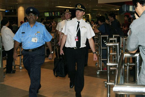 "<div class=""meta ""><span class=""caption-text "">Pilots from the Qantas passenger plane which made an emergency landing at Singapore's Changi International Airport after having engine problems are escorted out of the airport and onto buses which will be taking them to hotels, on Thursday, Nov. 4, 2010, in Singapore. Qantas grounded all six of its Airbus 380 superjumbos after one blew out an engine Thursday, shooting flames and raining large metal chunks before the world's largest airliner made a safe emergency landing in Singapore with 459 people aboard. (AP Photo/Wong Maye-E) (AP Photo/ Wong Maye-E)</span></div>"