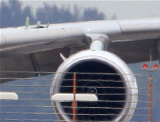 ** ALTERNATE CROP OF SIN105 ** Damage is seen on the wing, left top, above the engine which was shut down on a Qantas passenger plane which made an emergency landing in Singapore&#39;s Changi International Airport Thursday, Nov. 4, 2010 in Singapore. &#40;AP Photo&#47;Wong Maye-E&#41; <span class=meta>(AP Photo&#47; Wong Maye-E)</span>