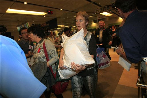 Passengers from the Qantas jetliner which made an emergency landing at Singapore&#39;s Changi International Airport after having engine problems are escorted out of the airport and onto buses which will be taking them to hotels, on Thursday, Nov. 4, 2010, in Singapore. &#40;AP Photo&#47;Wong Maye-E&#41; <span class=meta>(AP Photo&#47; Wong Maye-E)</span>