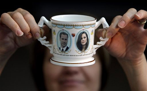 Guilder Lyn Holmes examines a &#39;Loving Mug&#39; made to mark the engagement of Prince William and Kate Middleton at Aynsley China in Stoke-on-Trent, England, Wednesday, Nov. 17, 2010. The company which was established in 1775 by John Aynsley has been producing commemorative tableware to mark royal occasions since the late 19th century. &#40;AP Photo&#47;Jon Super&#41; <span class=meta>(Photo&#47;JON SUPER)</span>