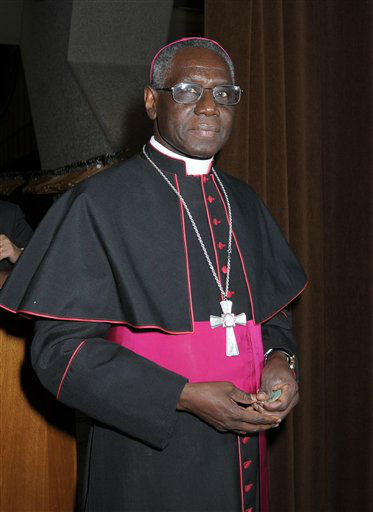Information below from The Vatican website    Cardinal Robert Sarah, President of the Pontifical Council &#34;Cor Unum&#34;, Archbishop emeritus of Conakry &#40;Guinea&#41;, was born on 15 June 1945 in Ourous, Guinea. After middle school, he was obliged to leave home in order to continue his studies at the minor seminary in Bingerville, Ivory Coast. Following Guinea&#39;s independence in 1958, he returned home and completed his studies.  He was ordained priest on 20 July 1969 in Conakry.  After his ordination, he earned a licentiate in theology at the Pontifical Gregorian University in Rome and a licentiate in Scripture at the &#34;Studium Biblicum Franciscanum&#34; in Jerusalem.  Upon completion of his studies, he was nominated rector of the minor seminary of Kindia, and served as parish priest in Bok?, Katace, Koundara and Ourous.  On 13 August 1979, he was appointed Archbishop of Conakry at the age of 34, making him the youngest bishop in the world and called &#34;the baby bishop&#34; by John Paul II. He was consecrated on 8 December 1979.  On 1 October 2001, he was appointed secretary of the Congregation for the Evangelization of Peoples.  On 7 October 2010, Pope Benedict XVI appointed him president of the Pontifical Council &#34;Cor Unum&#34;.  Created and proclaimed Cardinal by Benedict XVI in the consistory of 20 November 2010, of the Deaconry of San Giovanni Bosco in Via Tuscolana &#40;Saint John Bosco in Via Tuscolana&#41;. <span class=meta>(AP Photo&#47; Anonymous)</span>