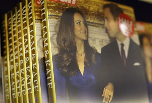 "<div class=""meta image-caption""><div class=""origin-logo origin-image ""><span></span></div><span class=""caption-text"">Books 'William and Kate : A Royal Love Story' by the Sun newspaper's royal reporter James Clench are seen on display for sale at a bookshop in London, Friday, Nov. 26, 2010. The book, published by Harper Collins and The Sun both owned by Rupert Murdoch's News Corp., is the first in a slew of new titles about the relationship between Prince William and Kate Middleton that publishers hope will set cash registers chirping in the months before their April 29 wedding at Westminster Abbey. (AP Photo/Sang Tan) (Photo/Sang Tan)</span></div>"