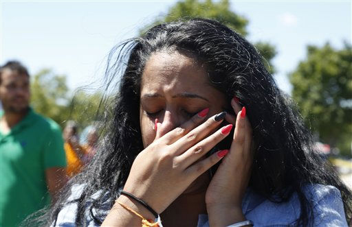 A woman reacts outside the Sikh Temple of Wisconsin in Oak Creek, Wis, after a shooting took place, Sunday, Aug 5, 2012.   <span class=meta>(AP Photo&#47; JEFFREY PHELPS)</span>