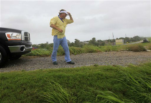 P.J. Hahn, Coastal Zone Director for Plaquemnies Parish, walks on a levee to survey flooding from Isaac, which is expected to make landfall in the region as a hurricane this evening in Venice, La.,  the southernmost tip of the state, Tuesday, Aug. 28, 2012.  Forecasters at the National Hurricane Center warned that Isaac, especially if it strikes at high tide, could cause storm surges of up to 12 feet &#40;3.6 meters&#41; along the coasts of southeast Louisiana and Mississippi and up to 6 feet &#40;1.8 meters&#41; as far away as the Florida Panhandle.   <span class=meta>(AP Photo&#47; Gerald Herbert)</span>