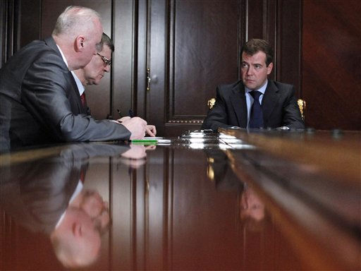 Russian President Dmitry Medvedev, right, holds a meting with Investigative Committee chief Alexander Bastrykin, left, and chief prosecutor Yuri Chaika, center, following an explosion at Domodedovo airport, in the Gorki residence outside Moscow, Monday, Jan. 24, 2011. Medvedev ordered authorities to beef up security at Moscow&#39;s two other commercial airports and other key transport facilities, including the subway system, the target of past terror attacks. He said the explosion demonstrated that security regulations had been breached. &#40;AP Photo&#47;RIA Novosti, Mikhail Klimentyev, Presidential Press Service&#41; <span class=meta>(AP Photo&#47; Mikhail Klimentyev)</span>