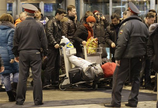 "<div class=""meta ""><span class=""caption-text "">Police officers watch passengers at Domodedovo airport in Moscow, Monday, Jan. 24, 2011.  An explosion ripped through the arrivals hall at Moscow's busiest airport on Monday, killing several dozen people and wounding more than a hundred. The Russian president called it a terror attack. (AP Photo/Ivan Sekretarev) (AP Photo/ Ivan Sekretarev)</span></div>"