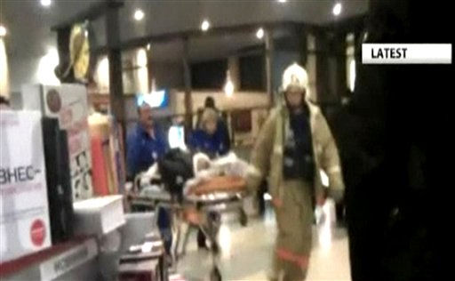 "<div class=""meta ""><span class=""caption-text "">In this image made from APTN video, a victim is wheeled from Domodedovo Airort, after an explosion ripped through the international arrivals hall Monday, Jan. 24, 2011 in Moscow.  The state RIA Novosti news agency, citing law enforcement sources, said the mid-afternoon explosion  may have been caused by a suicide bomber. (AP Photo, APTN) NO SALES (AP Photo/ AT**LON** CJ**NY**)</span></div>"