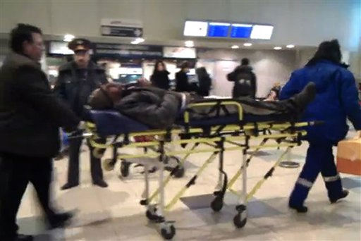 This image from the web site twitvid.com shows a stretcher with a victim of the explosion wheeled by rescuers in Domodedovo airport in Moscow, Monday, Jan. 24, 2011.  An explosion ripped through the arrivals hall at Moscow&#39;s busiest airport on Monday, killing several dozen people and wounding more than a hundred. The Russian president called it a terror attack. &#40;AP Photo&#47;Stanislav Grigoryev, twitvid.com&#41; <span class=meta>(AP Photo&#47; Stanislav Grigoryev)</span>