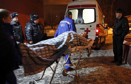 A wounded blast victim  is wheeled in a hospital near Domodedovo airport in Moscow, Monday, Jan. 24, 2011. A suicide bomber set off an explosion that ripped through Moscow&#39;s busiest airport on Monday, coating its international arrivals terminal in blood. The attack killed  dozens of people and wounded more than a hundred.  &#40;AP Photo&#47;Alexander Zemlianichenko&#41; <span class=meta>(AP Photo&#47; Alexander Zemlianichenko)</span>