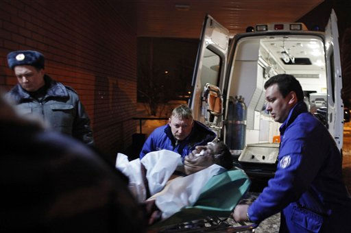 A wounded blast victim is brought by rescuers to a hospital from Domodedovo airport in Moscow, Monday, Jan. 24, 2011. A suicide bomber set off an explosion that ripped through Moscow&#39;s busiest airport on Monday, coating its international arrivals terminal in blood. The attack killed  dozens of  people and wounded more than a hundred.  &#40;AP Photo&#47;Alexander Zemlianichenko&#41; <span class=meta>(AP Photo&#47; Alexander Zemlianichenko)</span>