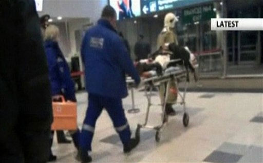 In this image made from APTN video, a victim is wheeled from Domodedovo Airort, after an explosion ripped through the international arrivals hall Monday, Jan. 24, 2011 in Moscow.  The state RIA Novosti news agency, citing law enforcement sources, said the mid-afternoon explosion  may have been caused by a suicide bomber. &#40;AP Photo, APTN&#41; NO SALES <span class=meta>(AP Photo&#47; AT**LON** CJ**NY**)</span>
