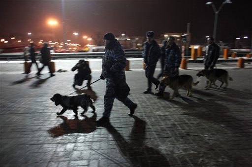 Police officers with sniffer dogs walk at Domodedovo airport in Moscow, Monday, Jan. 24, 2011. An explosion ripped through the international arrivals hall at Moscow&#39;s busiest airport on Monday, killing dozens of people and wounding scores, officials said. The Russian president called it a terror attack. &#40;AP Photo&#47;Alexander Zemlianichenko&#41; <span class=meta>(AP Photo&#47; Alexander Zemlianichenko)</span>