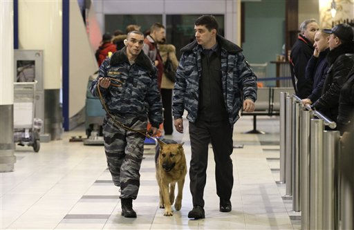 Police officers with a sniffer dog walk after an explosion at Domodedovo airport in Moscow, Monday, Jan. 24, 2011.  An explosion ripped through the arrivals hall at Moscow&#39;s busiest airport on Monday, killing many people. The Russian president called it a terror attack. &#40;AP Photo&#47;Ivan Sekretarev&#41; <span class=meta>(AP Photo&#47; Ivan Sekretarev)</span>