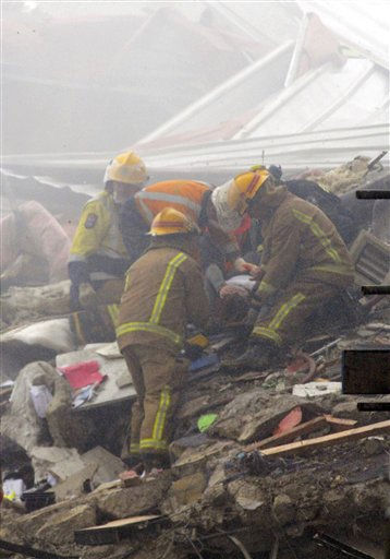 An injured women is dug out of rubble by rescue workers after an earthquake rocked Christchurch, New Zealand, Tuesday, Feb. 22, 2011. The 6.3-magnitude quake hit at the height of a busy workday Tuesday, toppling tall buildings and churches, crushing buses and killing dozens of people in one of the country&#39;s worst natural disasters.   <span class=meta>(AP Photo&#47; David Wethey)</span>