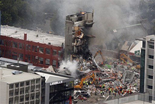 Rescue workers work to extinguish a fire at a collapsed building in central Christchurch, New Zealand, Tuesday, Feb. 22, 2011. A powerful earthquake collapsed buildings at the height of a busy workday killing and trapping dozens of people in one of the country&#39;s worst natural disasters.   <span class=meta>(AP Photo&#47; Mark Mitchell)</span>