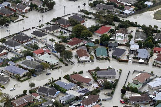 The Christchurch, New Zealand, suburb of Bexley is flooded following an earthquake, Tuesday, Feb. 22, 2011. A powerful earthquake collapsed buildings at the height of a busy workday Tuesday, killing and trapping dozens in one of the country&#39;s worst natural disasters.   <span class=meta>(AP Photo&#47; Mark Mitchell)</span>