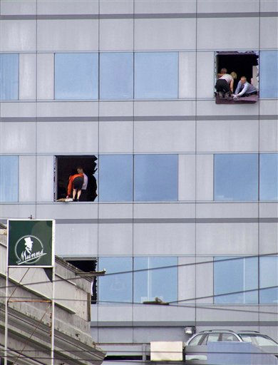 ALTERNATE CROP OF NZH809--People have broke windows to prepare to be rescued from a high-rise building in central Christchurch, New Zealand, Tuesday, Feb. 22, 2011. A powerful earthquake collapsed buildings at the height of a busy workday Tuesday, killing and trapping dozens in one of the country&#39;s worst natural disasters.  <span class=meta>(AP Photo&#47; Anonymous)</span>
