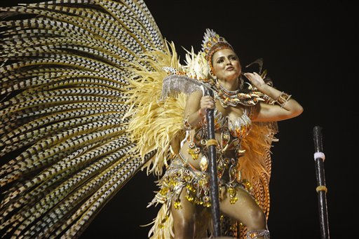 An Imperatriz Leopoldinense samba school dancer performs during a Carnival parade in the Sambadrome in Rio de Janeiro, Brazil, Sunday March 6, 2011. &#40;AP Photo&#47;Rodrigo Abd&#41; <span class=meta>(AP Photo&#47; Rodrigo Abd)</span>