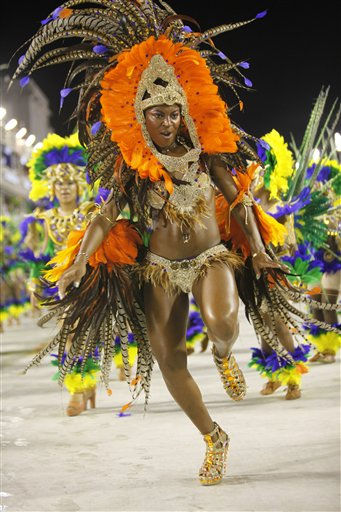 "<div class=""meta ""><span class=""caption-text "">Portela samba school dancers perform during their carnival parade in the Sambadrome in Rio de Janeiro, Brazil, early Monday March 7, 2011.  (AP Photo/Rodrigo Abd) (AP Photo/ Rodrigo Abd)</span></div>"