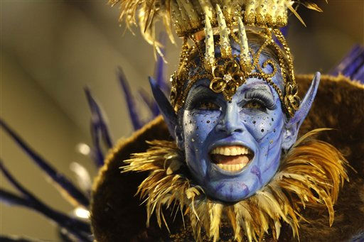 An Unidos da Tijuca samba school dancer performs during a carnival parade at the Sambadrome in Rio de Janeiro, Brazil, early Monday March 7, 2011. &#40;AP Photo&#47;Felipe Dana&#41; <span class=meta>(AP Photo&#47; Felipe Dana)</span>