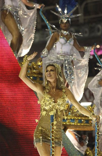 Brazilian top model Gisele Bundchen waves from a Vila Isabel samba school float during carnival celebrations in the Sambadrome in Rio de Janeiro, Brazil, early Monday March 7, 2011.  &#40;AP Photo&#47;Silvia Izquierdo&#41; <span class=meta>(AP Photo&#47; Silvia Izquierdo)</span>
